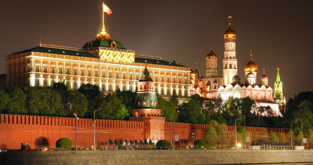 photo of Russia's federal government complex, the Kremlin - brightly lit at night