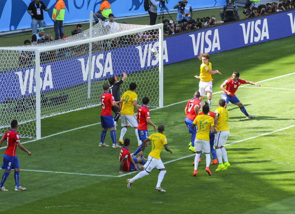 brazil vs chile soccer match - players in goal area