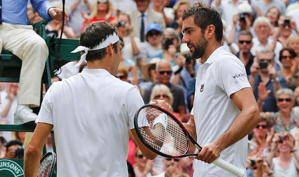 Roger Federer and Marin Cilic shake hands after Wimbledon final