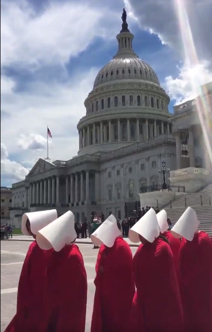 "Planned Parenthood protesters donning ""Handmaid's Tale"" costumes to suggest the narrative of paternal repression."
