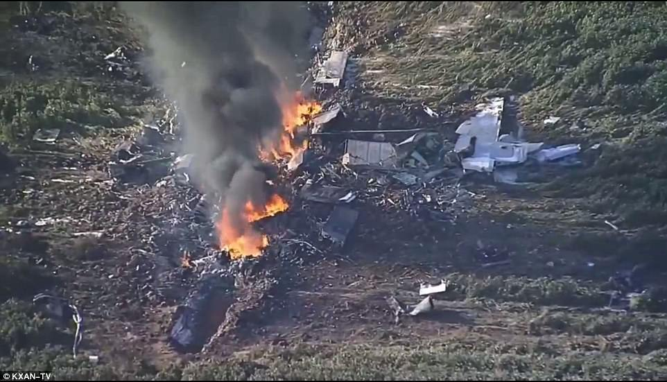 Mississippi crash scene of military KC 130T in rural Mississippi , showing still burning wreckage and debris.