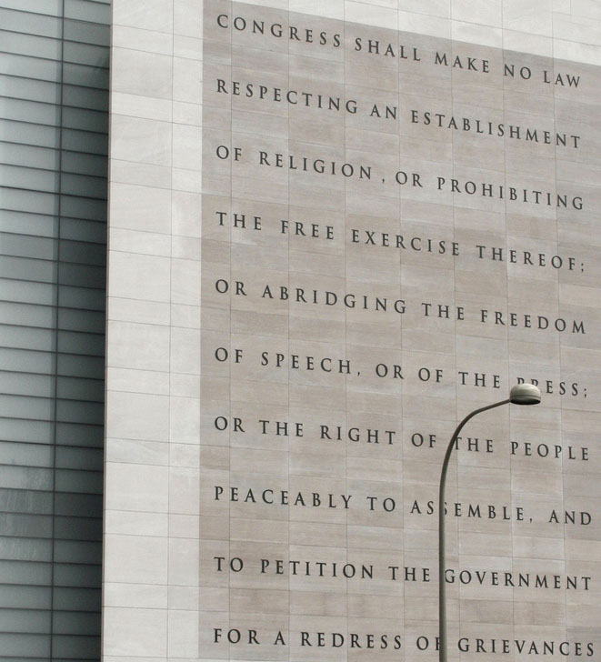 tall architectural feature with the text of the First Amendment