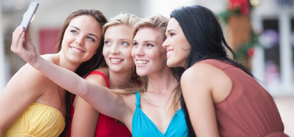 young ladies taking a 'selfie' picture together