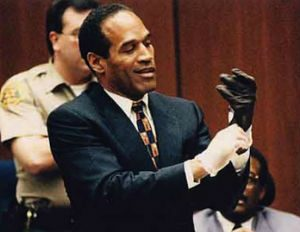 O.J. Simpson holding the infamous prosecution evidence in court - the Glove that wouldn't fit