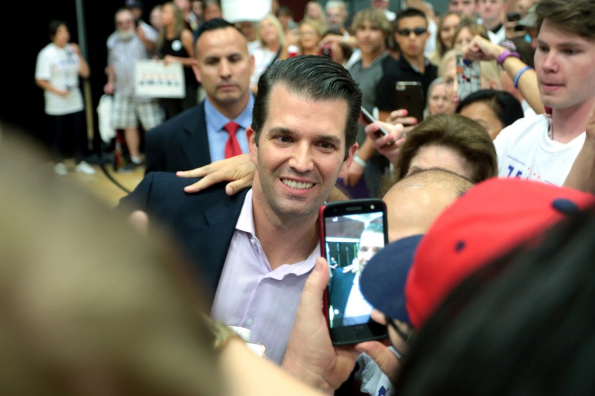 Donald Trump Jr. poses for photo at Trump Campaign rally