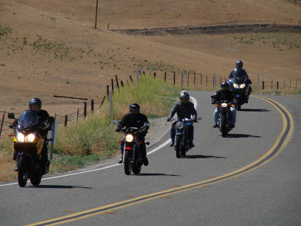 line of motorcyclists sport touring on rural highway