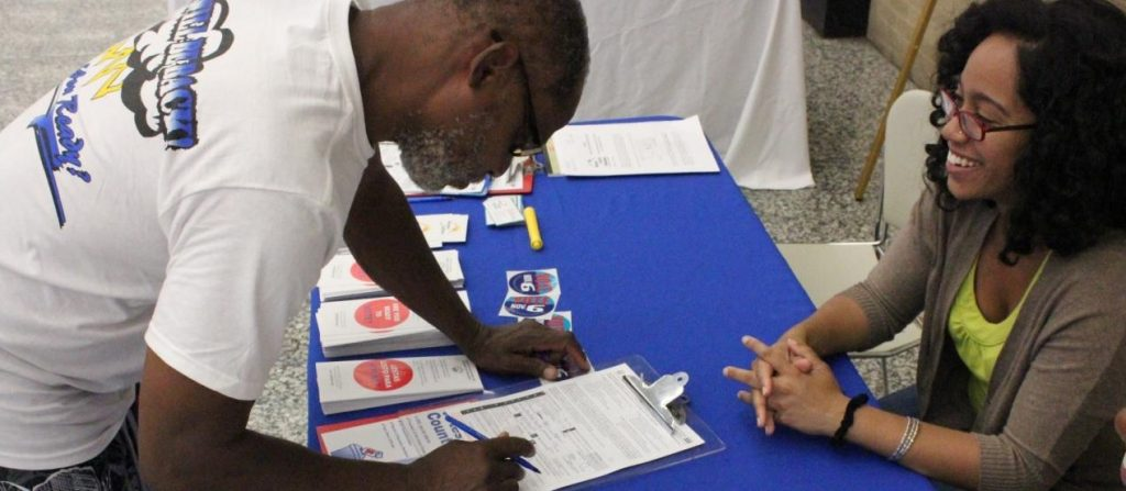 homeless man registering to vote in Washington D.C. voter drive