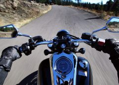 photo of motorcycle from rider's forward point of view with gloved hands on handlebars