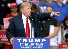 Trump at his speaking podium during rally in Phoenix, Arizona