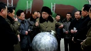 "North Korean dictator Kim Jong Un conferring with military and government officials in front of an unknown large aluminum object that Western reporters dub the ""Disco Ball"""
