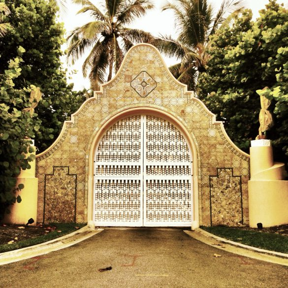 photo of one of the estate gates at Mar a Lago, lavishly decorated in gold paint
