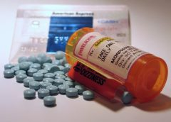photo of bottle of morphine pills open with pills spread out on counter