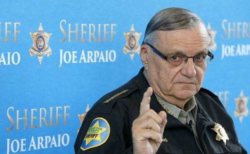 publicity photo of former Sheriff Joe Arpaio holding up a warning finger