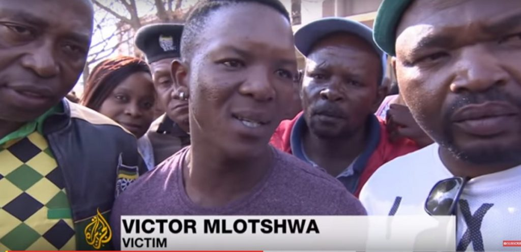Victor Mlotshwa, victim of attempted murder by two South African farmers, speaks to reporters after the trial