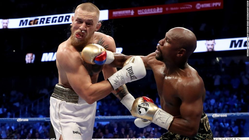 Mayweather landing close in punch to McGregor's jaw.