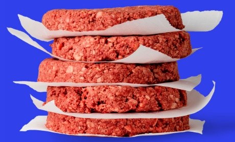 "photo of uncooked ""Impossible Burger"" patties"