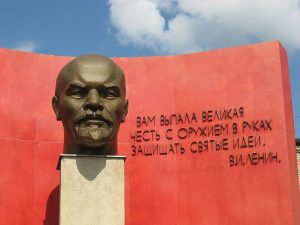 Monument to Vladimir Lenin - a Bronze head on pedestal with a wall behind and inscription in Cyrillic. In Minsk