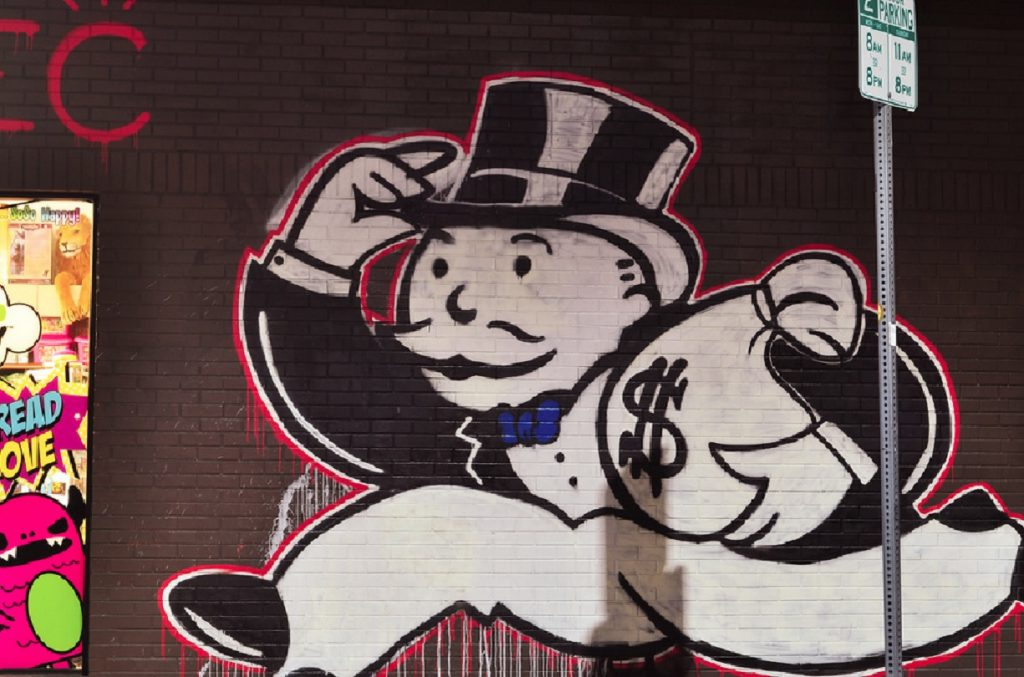"""Store front mural of """"Mr Money Bags"""" - the iconic character of the Monopoly Game"""