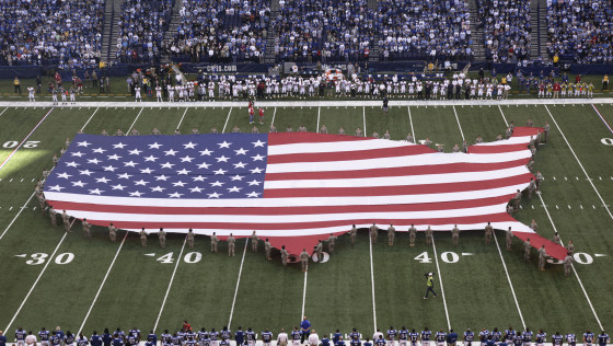 "In this Sunday, Nov. 8, 2009 file photo, a U.S. flag in the shape of the continental United States is displayed on the field of Lucas Oil Stadium before an NFL football game between the Indianapolis Colts and the Houston Texans in Indianapolis. Marc Leepson, author of ""Flag: An American Biography,"" agrees. ""We don't have a monarch or a state religion,"" he says. ""In some ways, the flag is a substitute."" (AP Photo/AJ Mast)"