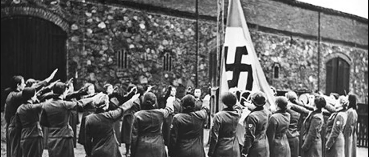 1930s era photo of Nazi women saluting Swastika