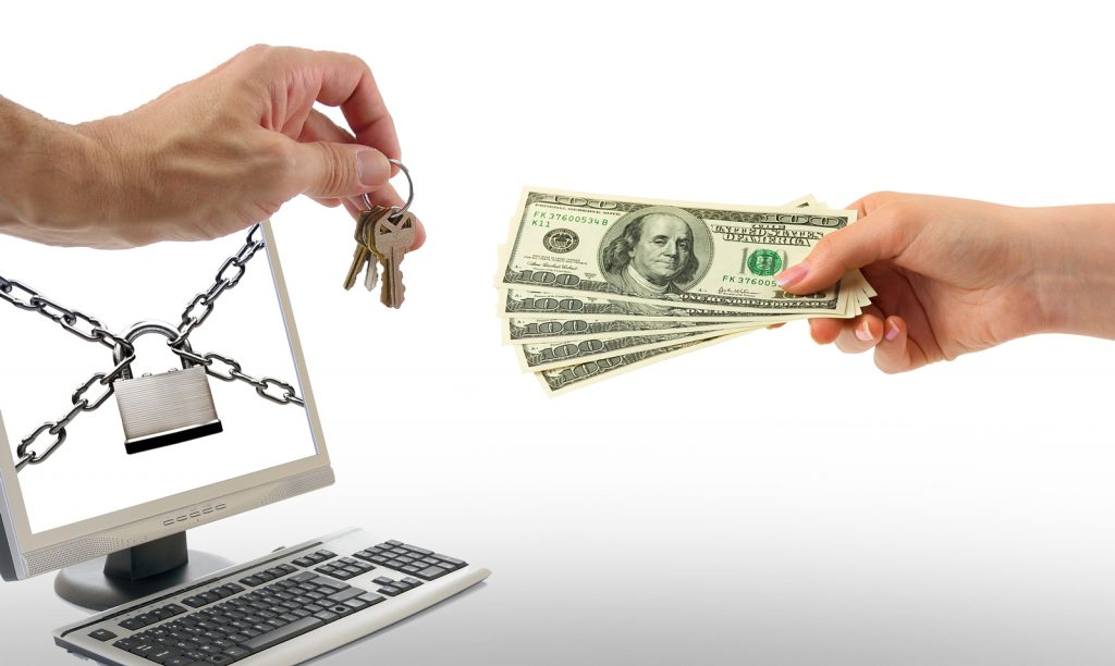 image depicting a hand passing several $100 bills in exchange for a key - representing a de-encryption key used to gain back data and computer files held hostage by ransomware