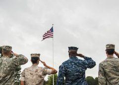 Service Members salute flag