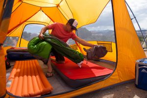 camping tent interior with air foam mattresses and sleeping bags