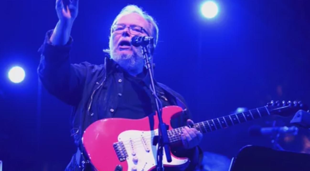 video still of Steely Dan co-founder Walter Becker performing in concert in 2016