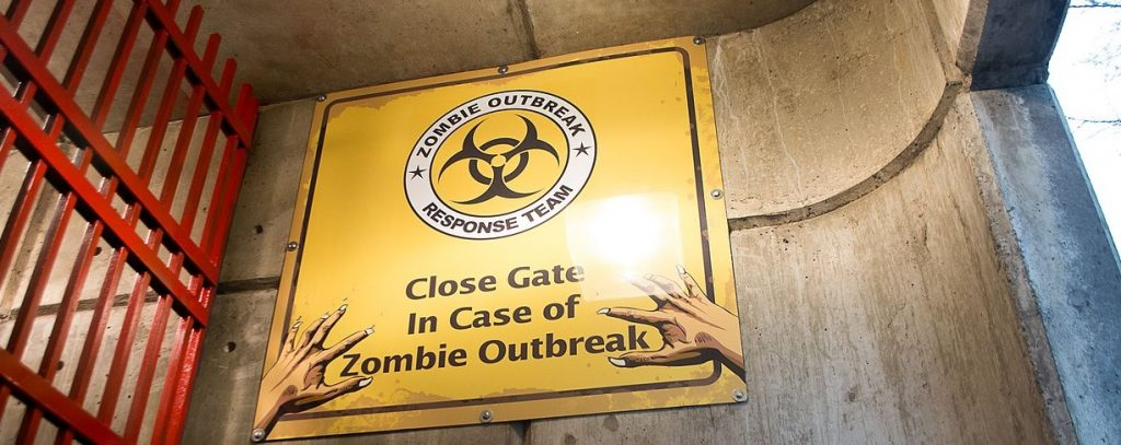 "Sign in front of gate - ""Close Gate In Case of Zombie Outbreak"""
