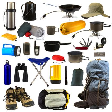 assortment of essential items to have in a survival / prepper / camping situation (flashlights, thermos, bedrolls, army knives, cooking utinsels, etc.)