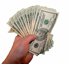handful of U.S. currency ($100 dollar bills) representing capital