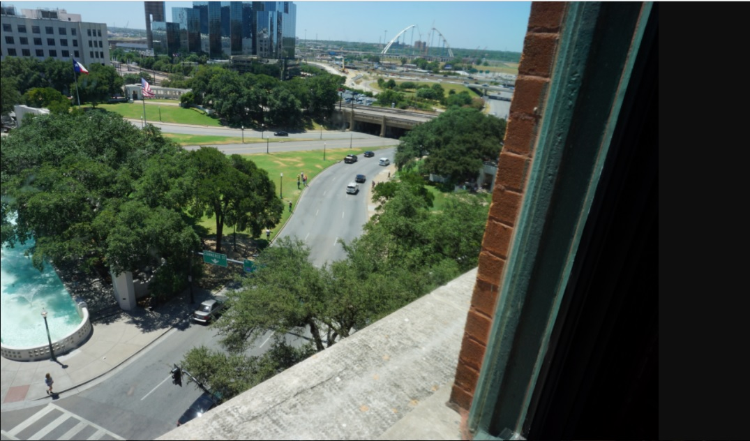 photo of the portion of the Dallas Motorcade route of JFK as viewed from the window of the 6th floor of the Dallas School Book Depository