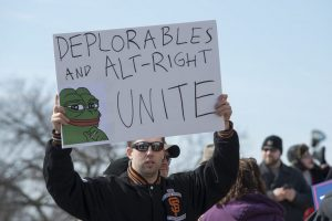 Deplorable holding sign