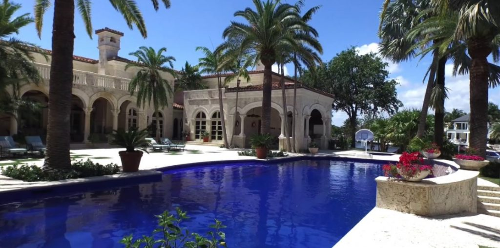 photo of Palm Beach mansion with lagoon sized pool