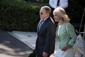 Sean Spicer and Kellyanne Conway walking together on White House grounds