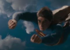 video still of D.C. comics superhero Superman in flight rescuing the falling passenger cabin and fuselage of a jumbo jet.
