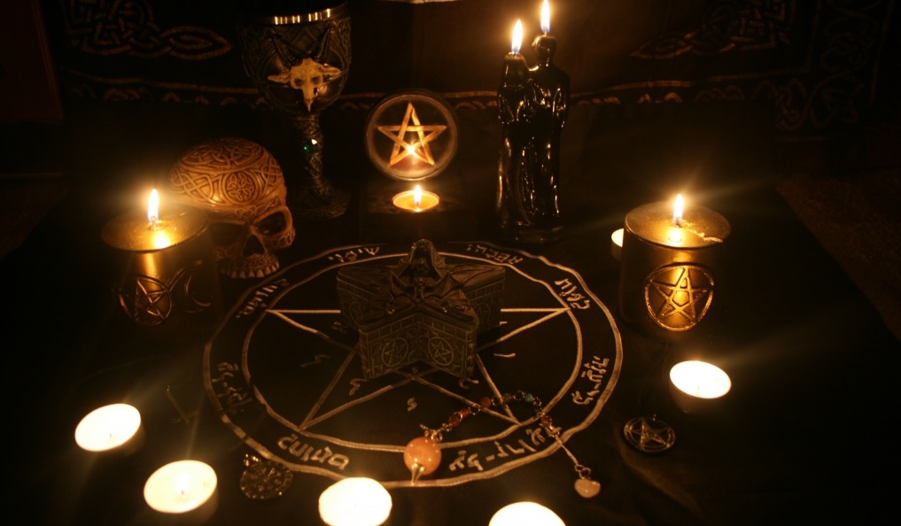 visual depiction of magic candles and spell talismans