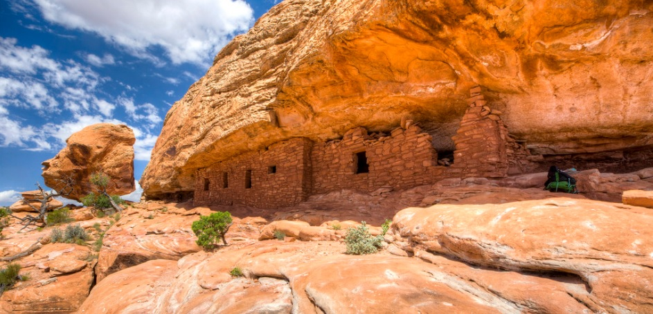 photo of ancient Navajo dwellings underneath an overhanging rock formation in Bears Ears National Monument