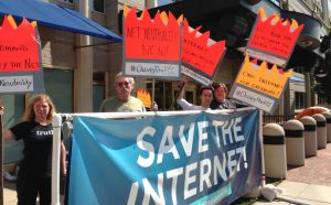 photo of group protesting the cancellation of Net Neutrality rules