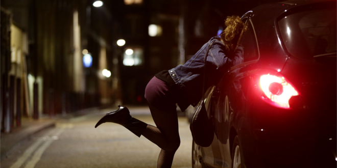 photo image of a sex worker soliciting a john in a vehicle