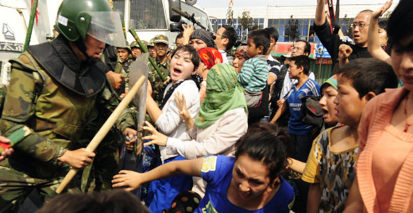 Chinese security troops committing violence against ethnic Uyghur protesters