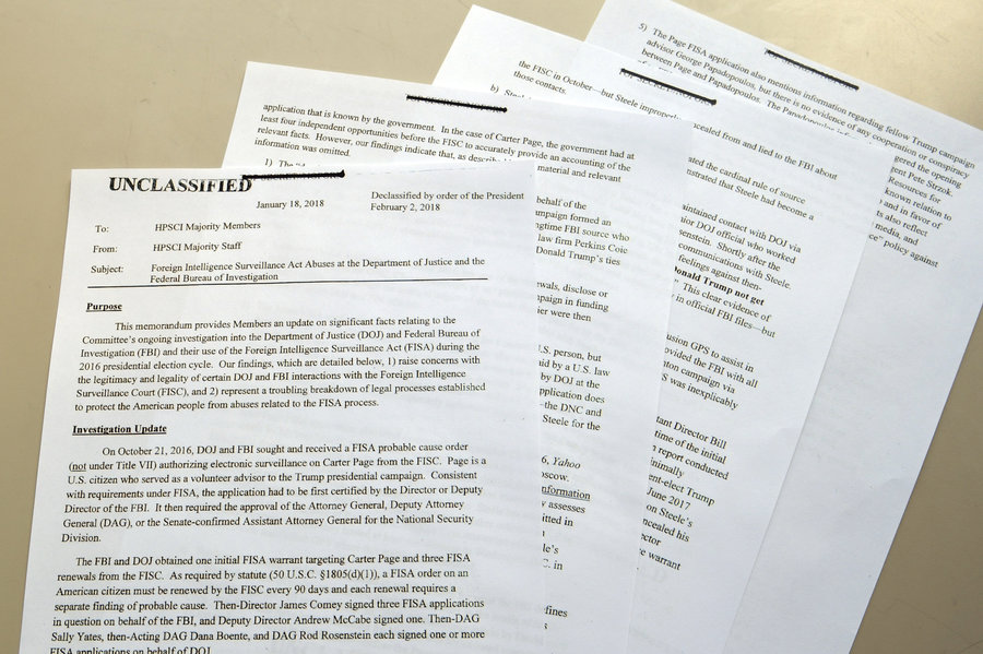 "photo of pages of a copy of the GOPs House Intelligence Committee report on the FISA Court surveillance order, known as the ""Nunes Memo"""