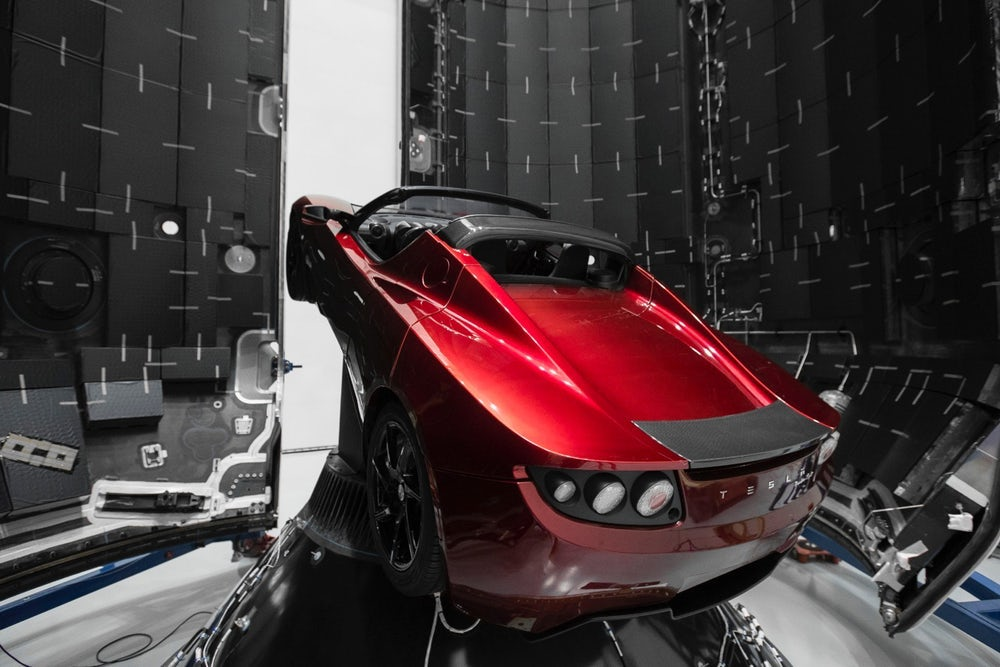 Tesla convertible roadster in payload area of SpaceX's Falcon Heavy
