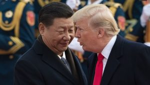 photo of American president Donald Trump greeting Chinese dictator Xi Jinping