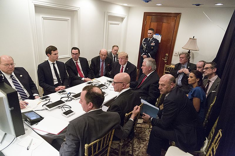 President Donald Trump receives a briefing, Thursday, April 6, 2017, on a military strike on Syria, from his National Security team, including a video teleconference with U.S. Secretary of Defense, Gen. James Mattis, and Chairman of the Joint Chiefs of Staff, Gen. Joseph F. Dunford, in a secured location at Mar-a-Largo in Palm Beach, Florida.