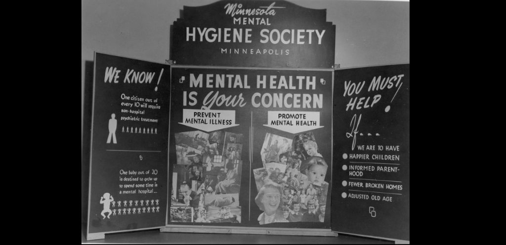 photo of an informational display from the post war era, created by the Minnesota Mental Hygiene Society, touting the benefits to individuals and society of mental health treatment and counseling.