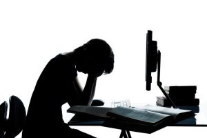 image of student experiencing depression. Image furnished by Family Guidance Center. http://fgcnow.org/tag/students-with-depression/
