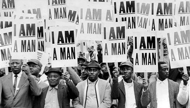 press photo (Copley News) of black men protesting in Memphis during the Sanitation Worker strike in 1968