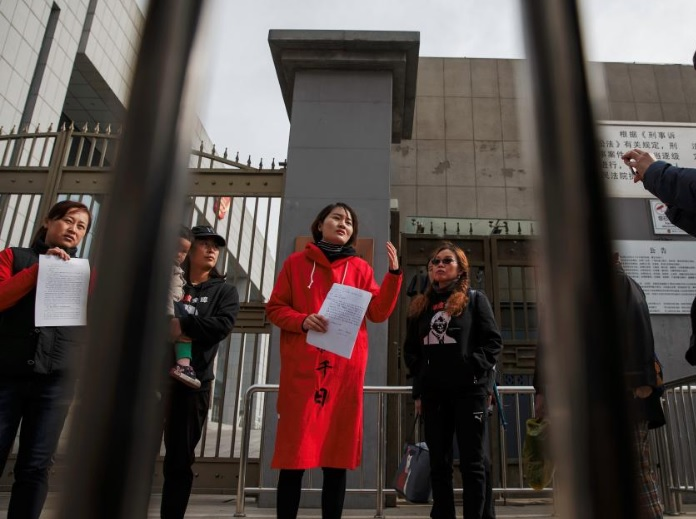 Li Wenzu, wife of detained Chinese rights lawyer Wang Quanzhang, talks to reporters outside a Supreme People's Court complaints office in Beijing, China April 4, 2018. REUTERS/Damir Sagolj
