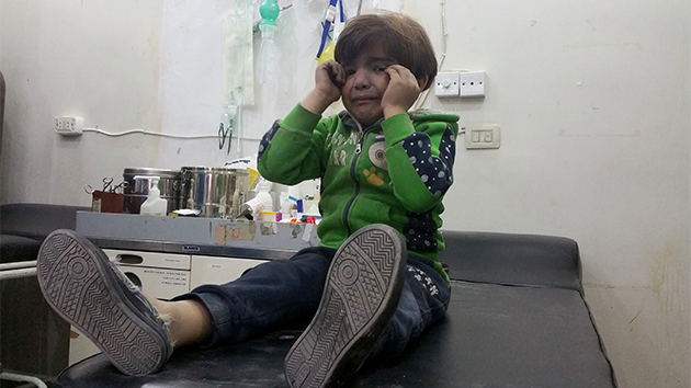 A young Syrian child is treated at a hospital following Syrian government chemical attacks on civilian targets last week.